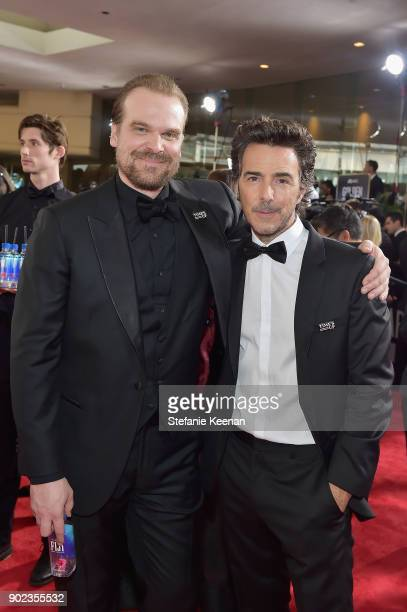 Actor David Harbour and director Shawn Levy attend The 75th Annual Golden Globe Awards at The Beverly Hilton Hotel on January 7 2018 in Beverly Hills...