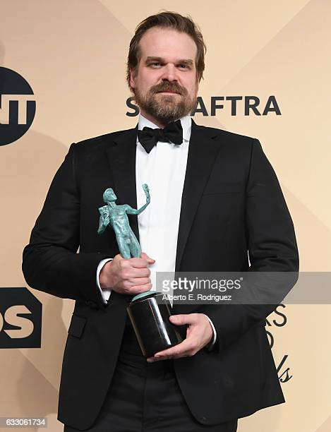Actor David Harbour corecipient of the Outstanding Performance by an Ensemble in a Drama Series award for 'Stranger Things' poses in the press room...