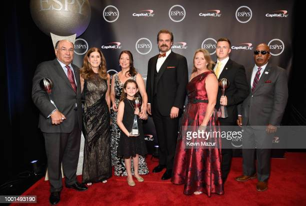 Actor David Harbour poses with the families and fellow coach of Marjory Stoneman Douglas High School coaches Aaron Feis Scott Beigel and Chris Hixon...