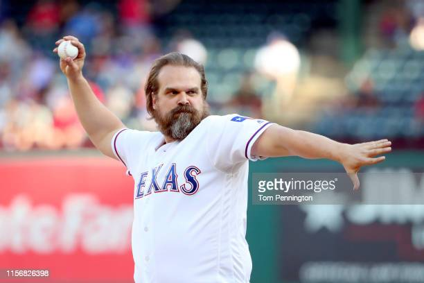 "Actor David Harbour, who portrays Jim Hopper on ""Stranger Things"" throws out the ceremonial first pitch before the Texas Rangers take on the..."