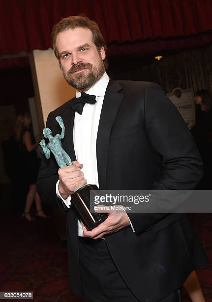 Actor David Harbour, winner of the Outstanding Ensemble in a Drama Series award for 'Stranger Things,' poses during The 23rd Annual Screen Actors...