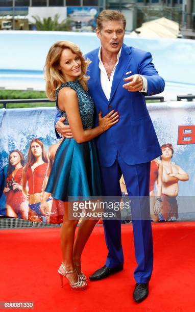 US actor David Hasselhoff and his fiancee Hayley Roberts pose during a photocall to promote the Europe premiere of the movie 'Baywatch' on May 30...