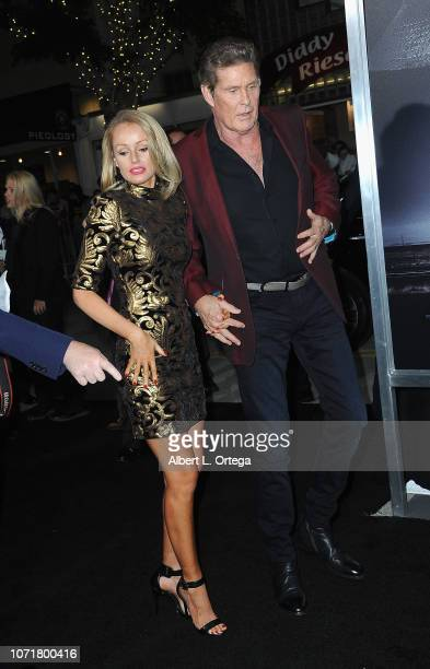 Actor David Hasselhoff and wife Hayley Roberts arrive for the Warner Bros Pictures World Premiere Of The Mule held at Regency Village Theatre on...