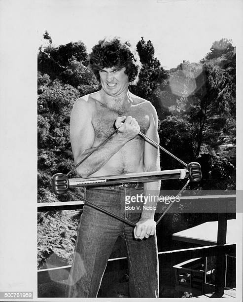Actor David Hasselhoff jokingly practicing body building exercises at his home in the Hollywood Hills California November 21st 1979