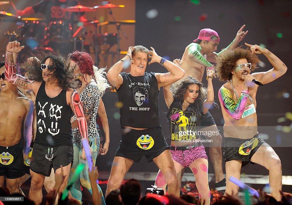 Actor David Hasselhoff (C) performs with singers SkyBlu and Redfoo of LMFAO onstage at the 2011 American Music Awards held at Nokia Theatre L.A. LIVE on November 20, 2011 in Los Angeles, California.