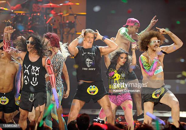 Actor David Hasselhoff performs with singers SkyBlu and Redfoo of LMFAO onstage at the 2011 American Music Awards held at Nokia Theatre LA LIVE on...