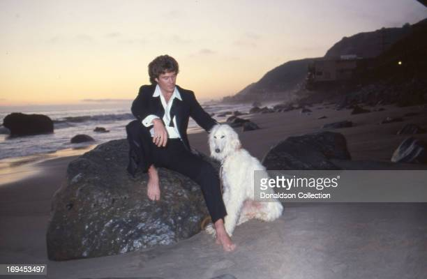 Actor David Hasselhoff poses for a portrait session wearing a tuxedo with his dog in 1984 in Los Angeles California