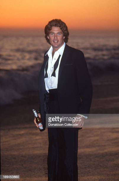 Actor David Hasselhoff poses for a portrait session wearing a tuxedo drinking a Dos Equis beer in 1984 in Los Angeles California