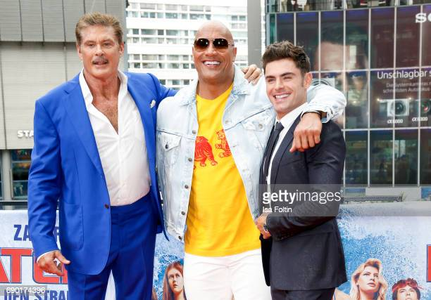 US actor David Hasselhoff US Wrestler and actor Dwayne Johnson and US actor and singer Zac Efron attend the 'Baywatch' Photo Call in Berlin on May 30...