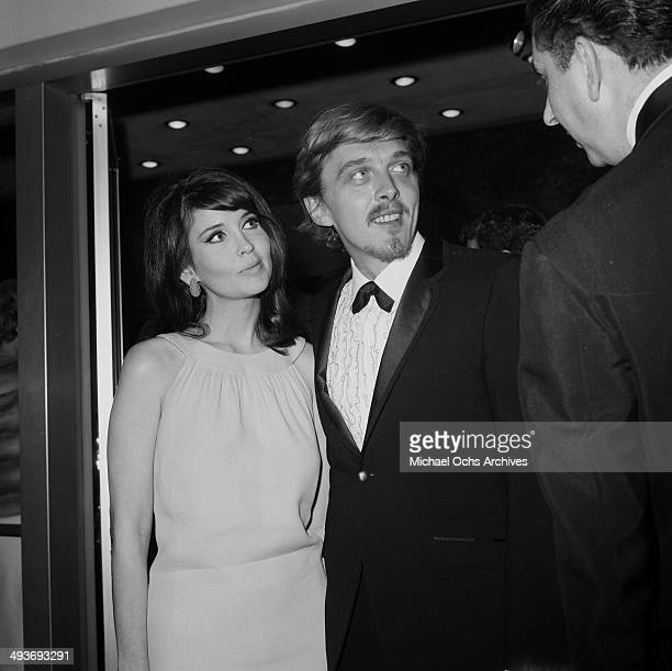 Actor David Hemmings with actress Anjanette Comer arrive at a party in Los AngelesCalifornia