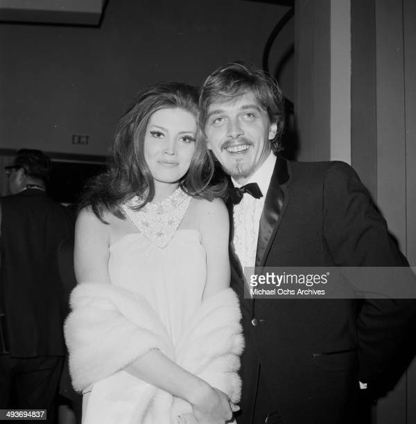 Actor David Hemmings with wife actress Gayle Hunnicut arrive at a party in Los Angeles California