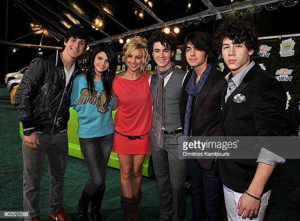 Actor David Henry actress Selena Gomez actress Chelsea Staub musician Kevin Jonas musician Joe Jonas and musician Nick Jonas arrive at Chevy Rocks...