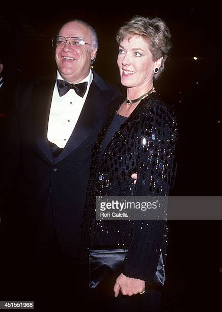 Actor David Huddleston and date attend Santa Claus The Movie New York City Premiere on November 20 1985 at the Ziegfeld Theatre in New York City