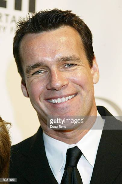 Actor David James Elliott arrives at Saks Fifth Avenue's Unforgettable Evening at the Regent Beverly Wilshire on March 1 2004 in Beverly Hills...