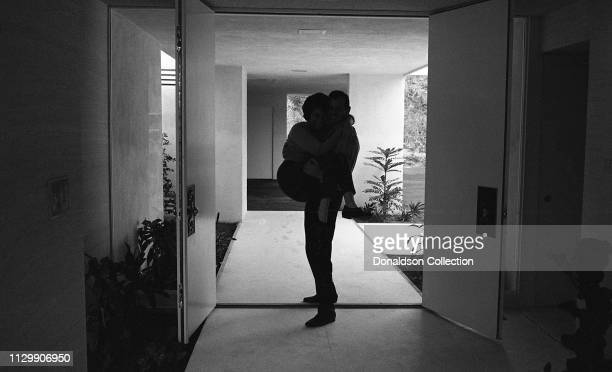Actor David Janssen of The Fugitive at home with his wife Ellie Graham in circa 1963