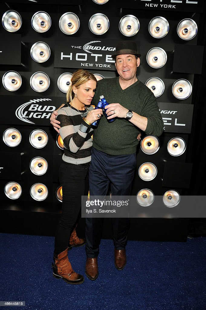 Actor David Koechner(R) and Leigh Koechner attend the Bud Light Hotel on February 1, 2014 in New York City.