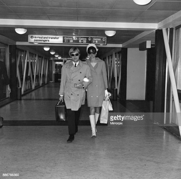 Actor David McCallum one of the stars of the TV show 'The Man from UNCLE' leaving Heathrow Airport for New York with his wife Katherine Carpenter...