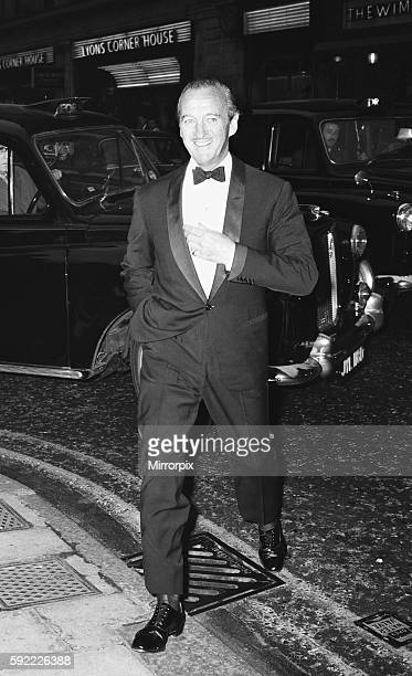 """Actor David Niven aarrives at the Prince of Wales Theatre in London for the opening night the musical production """"Funny Girl"""" starring Barbara..."""