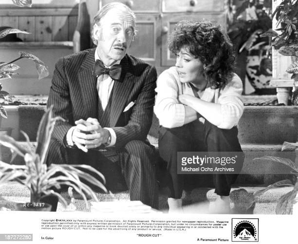 """Actor David Niven and actress Lesley-Anne Down on set of the Paramount Pictures movie """"Rough Cut"""" in 1980."""