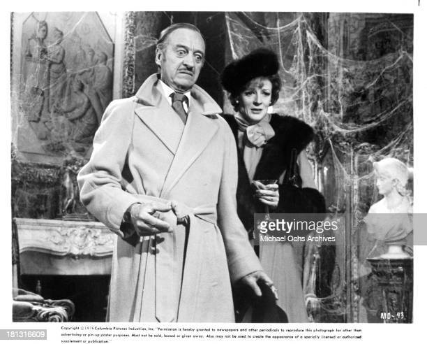 Actor David Niven and Maggie Smith on the set of Columbia Pictures movie 'Murder by Death' in 1976