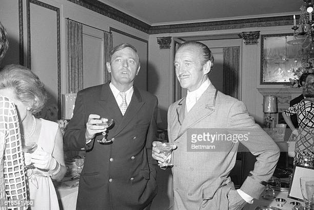 Actor David Niven, , chats with author and magazine publisher William Buckley during a reception following the wedding of his son, James Niven, to...