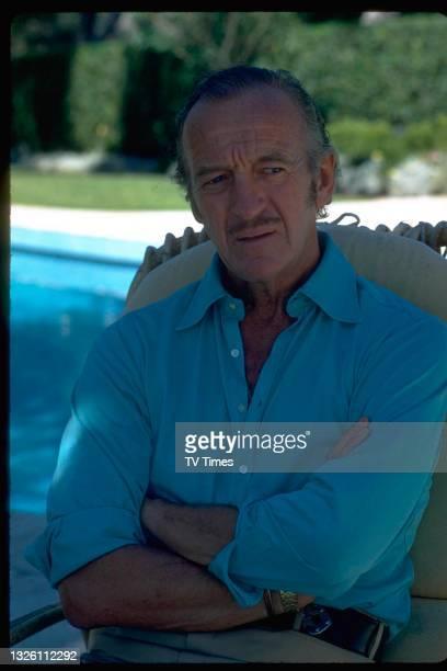 Actor David Niven sitting by the swimming pool at his villa in Saint-Jean-Cap-Ferrat, France, circa 1971.