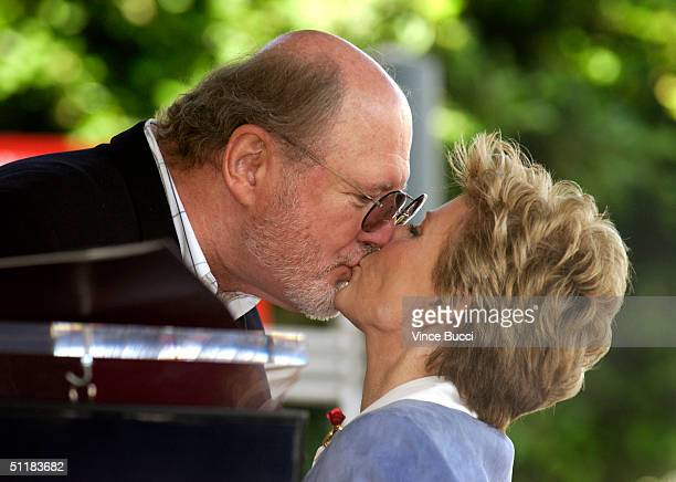 Actor David Ogden Stiers kisses actress Patty Duke at the ceremony honoring Duke with a star on the Hollywood Walk of Fame August 17 2004 in...