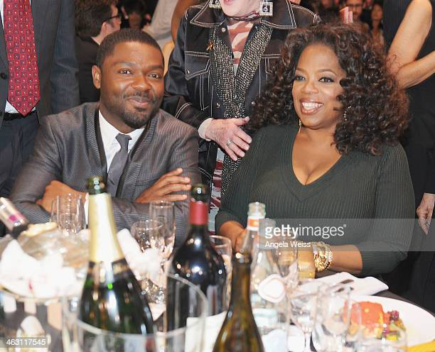 Actor David Oyelowo and Oprah Winfrey with Napa Valley Vintners And Sapporo attend the 19th Annual Critics' Choice Movie Awards at Barker Hangar on...