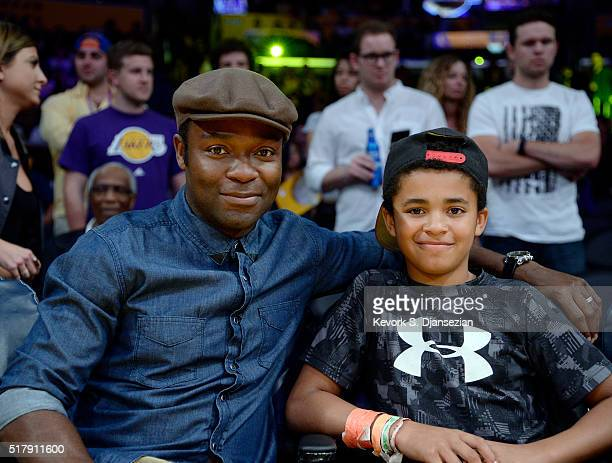 Actor David Oyelowo and son Caleb attend the basketball game between the Denver Nuggets and the Los Angeles Lakers at Staples Center on March 25 2016...