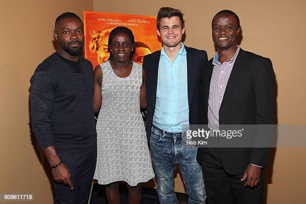 Actor David Oyelowo and World Chess Champion Magnus Carlsen pose with real life film subjects Phiona Mutesi and Robert Katende before participating...