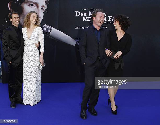 Actor David Rott with his wife Elena and Ulrich Noethen with MarieLuise Schmidt attend the 'Der Mann mit dem Fagott' premiere at CineStar on...