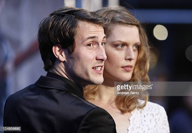 Actor David Rott with his wife Elena attend the 'Der Mann mit dem Fagott' premiere at CineStar on September 14 2011 in Berlin Germany