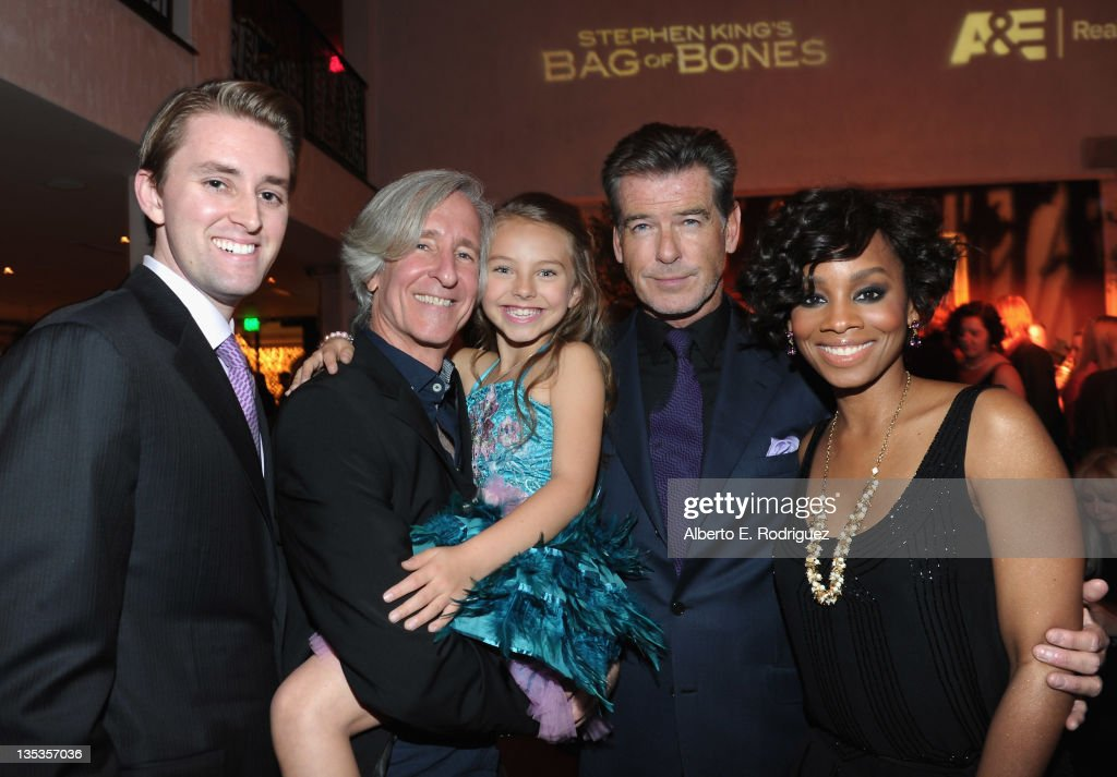 Actor David Sheftell, director Mick Garris, actress Caitlin Carmichael, actor Pierce Brosnan and actress Anika Noni Rose attend A&E's premiere party event for Stephen King's 'Bag of Bones' at Fig & Olive Melrose Place on December 8, 2011 in West Hollywood, California.