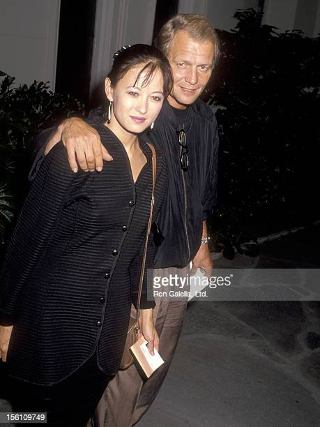 Actor David Soul and wife Actress Julia Nickson attend the Memorial Service for Mitch Snyder on July 17 1990 at First United Methodist Church of...