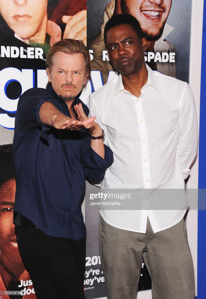 Actor David Spade (L) and comedian Chris Rock attend the 'Grown Ups 2' New York Premiere at AMC Lincoln Square Theater on July 10, 2013 in New York City.