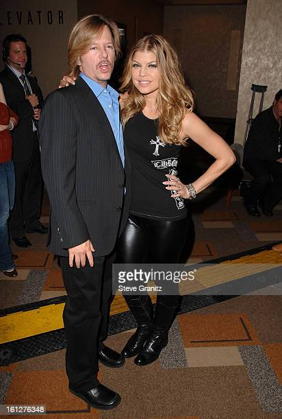 Actor David Spade and singer Fergie arrive at the taping of Idol Gives Back held at the Kodak Theatre on April 6 2008 in Hollywood California