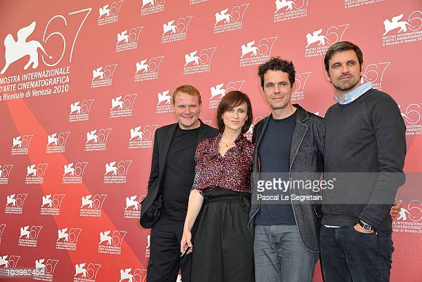 Actor David Striesow actress Sophie Rois director Tom Tykwer and actor Sebastian Schipper attend the Drei photocall during the 67th Venice Film...