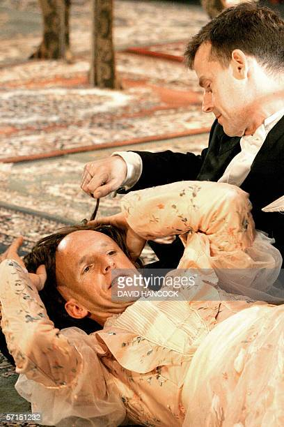 """Actor David Woods loses his wig to Jon Haynes during a romantic moment in a wildly unconventional rendition of the famous Oscar Wilde comedy """"The..."""