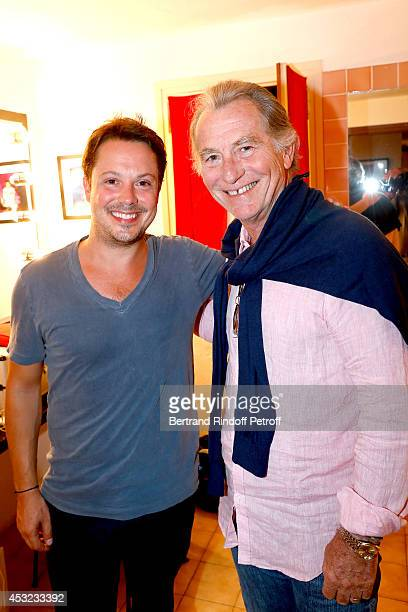 Actor Davy Sardou and TV presenter William Leymergie pose backstage after 'L'Affrontement' play during the 30th Ramatuelle Festival Day 5 on August 5...