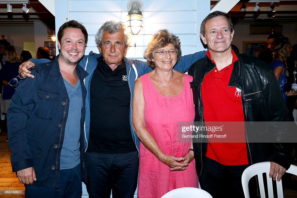 Actor Davy Sardou, artistic Director of the Festival Michel Boujenah, President of Ramatuelle Festival Jacqueline Franjou and actor Francis Huster pose after 'L'Affrontement' play during the 30th Ramatuelle Festival : Day 5 on August 5, 2014 in Ramatuelle, France.