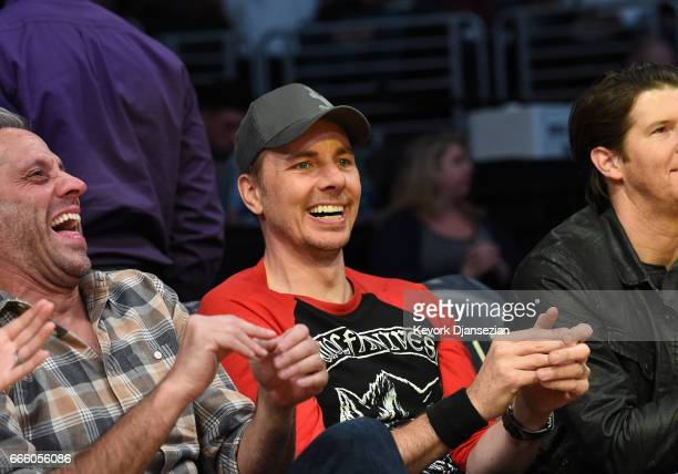 Actor Dax Shepard cheers for the Laker girls as they perform during the Sacramento Kings and Los Angeles Lakers basketball game at Staples Center...
