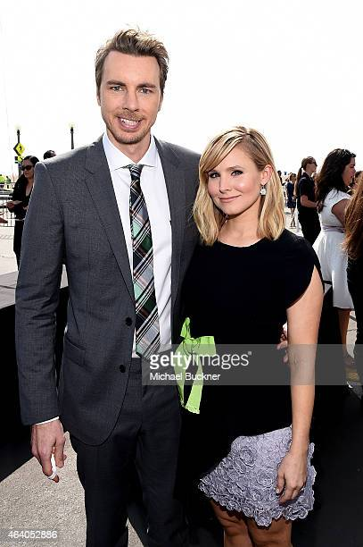 Actor Dax Shepard poses with actress Kristen Bell outside the FIJI Water tent during the 30th Annual Film Independent Spirit Awards at Santa Monica...