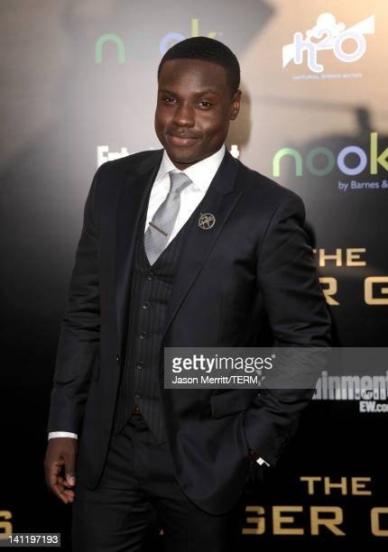 Actor Dayo Okeniyi arrives at the premiere of Lionsgate's The Hunger Games at Nokia Theatre LA Live on March 12 2012 in Los Angeles California