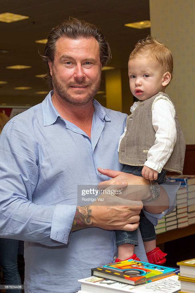 Actor Dean McDermott (L) and son Finn McDermott attend as Tori Spelling signs copies of her new book 'Spelling It Like It Is' at Barnes & Noble bookstore at The Grove on November 9, 2013 in Los Angeles, California.
