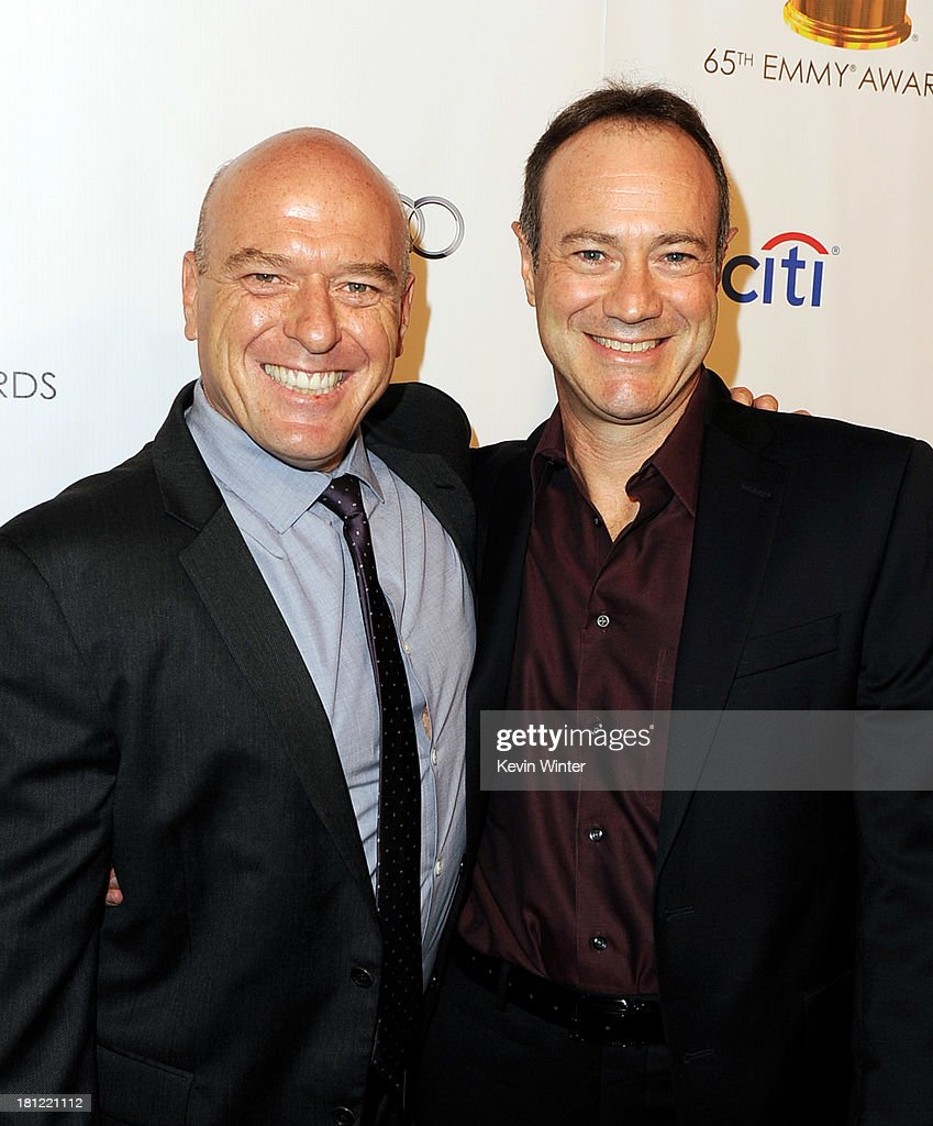 Actor Dean Norris (L) and writer George Mastras of Breaking Bad arrive at the 65th Primetime Emmy Awards Writer Nominees reception at the Academy of Television Arts & Sciences on September 19, 2013 in No. Hollywood, California.