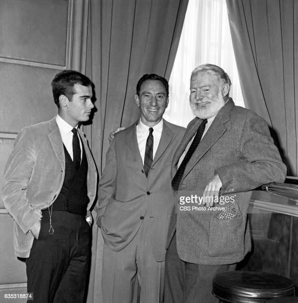 Actor Dean Stockwell and writer and executive producer A E Hotchner pose for a photo with Nobel prize winning author Ernest Hemingway Hemingway...