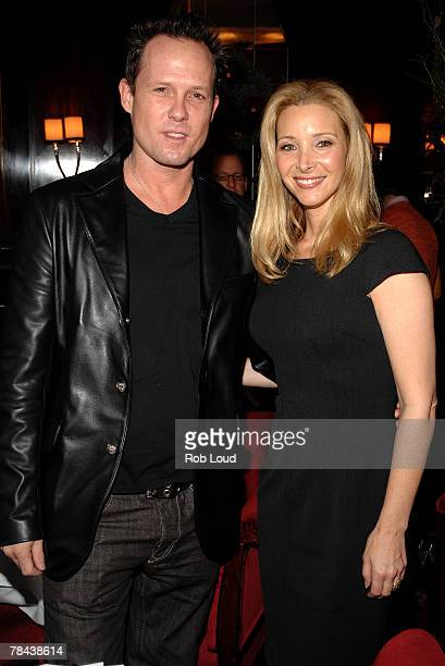 Actor Dean Winters and actress Lisa Kudrow pose at a luncheon for 'PS I Love You' at Brasserie Ruhlmann on December 12 2007 in New York City