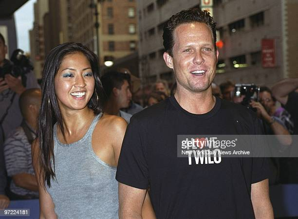 Actor Dean Winters and friend Fannie Chan arrive at Madison Square Garden to see the first of Madonna's five Drowned World Tour concerts in New York