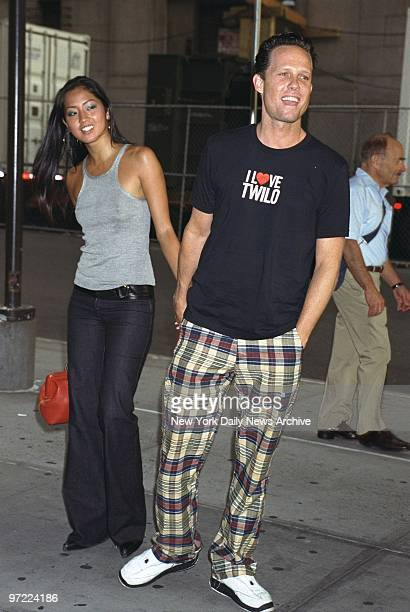 Actor Dean Winters and friend Fannie Chan arrive at Madison Square Garden to see the second of Madonna's five Drowned World Tour concerts in New York