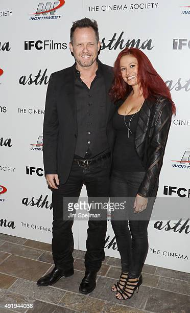 Actor Dean Winters and guest attend the screening of IFC Films' Asthma hosted by The Cinema Society and Northwest at the The Roxy Hotel on October 8...
